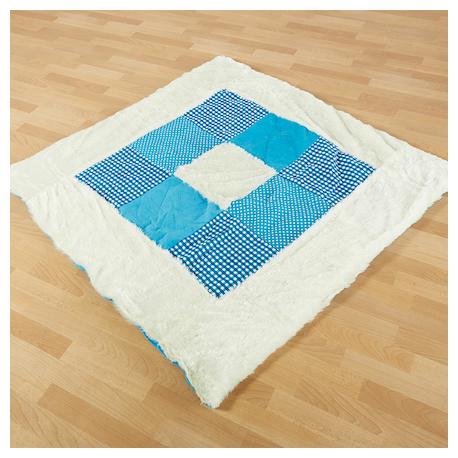 Tapis et coussins bleus texturés